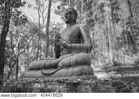Phayao, Thailand - Dec 6, 2020: Low Angle Black And White Front Left Buddha Statue Giving The Firts