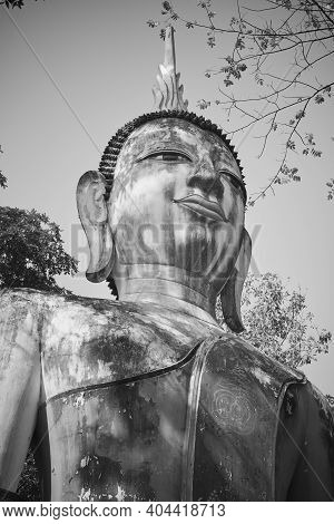 Phayao, Thailand - Dec 6, 2020: Portrait Zoom View Black And White Front Right Meditation Buddha Sta