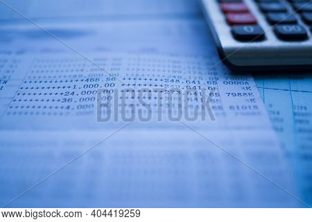 Plan Save Money 2021 Concept. Blur Image Of Bankbook And Calculator. For Background Finance.