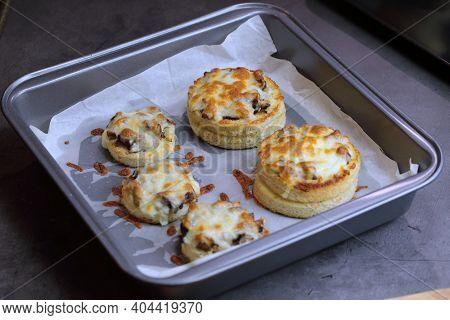 A Baking Tray With Cheesy Mushroom Croustades Or Cheesy Mushroom Discs, Top Down.