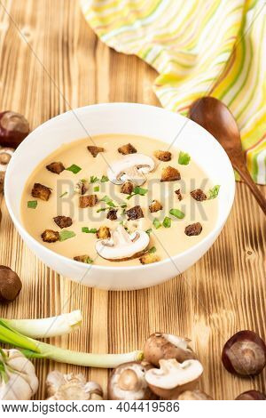 Traditional French Cream Soup Of Chestnuts With Croutons On A Wooden Background.