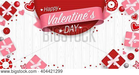 Greeting Card Of Happy Valentine's Day On A Pink Ribbon On A Red Background Surrounded By Gift Boxes