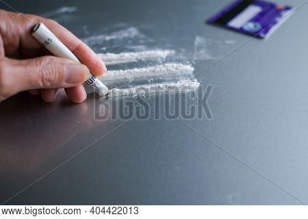 Narcotic Recreational Drugs, Substance Abuse Or  Concept. Cocaine Divided With Banknote Round Roll,