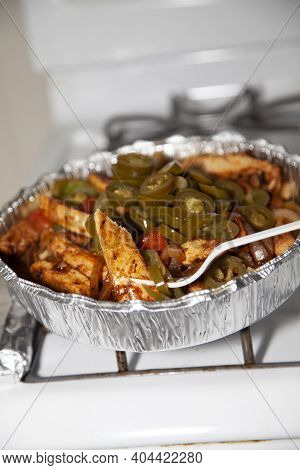 Stir Fried Chicken In A Serving Tin With Jalapenos, Roasted Green Bell Peppers, Roasted Onions, And