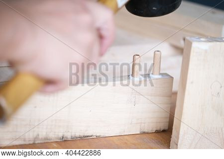 Focus On The Woodwork, Entrepreneur  Woodwork Holding Hammer To Assemble The Wood Pieces As The Cust