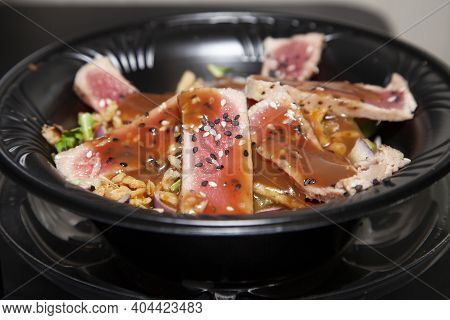 Seared Tuna Salad Topped With Seeds And Brown Sauce