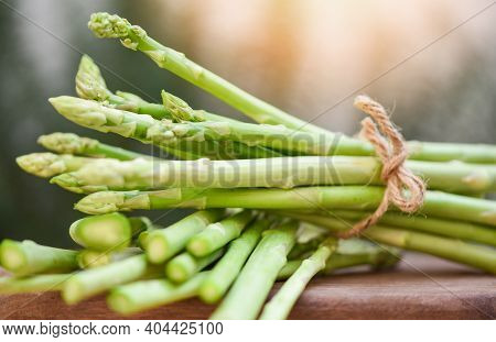 Bundle Of Fresh Green Asparagus On A Rustic Wooden Table, Asparagus Bunch For Cooked Food