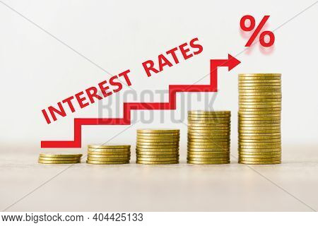 Interest Rate Financial And Mortgage Rates Concept, Stack Of Coin Showing Percentage Increase Graph