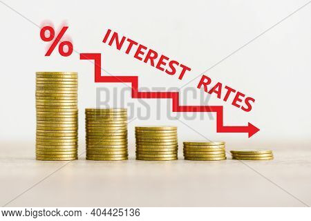 Interest Rate Financial And Mortgage Rates Concept, Stack Of Coin Showing Percentage Decrease Graph