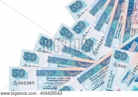 50 Sri Lankan Rupees Bills Lies In Different Order Isolated On White. Local Banking Or Money Making