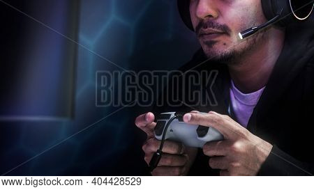 Professional eSport gamer playing a game with gaming controller