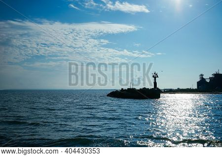 Seascape With A Silhouette Of A Lighthouse And A Coastline. Kerch, Crimea