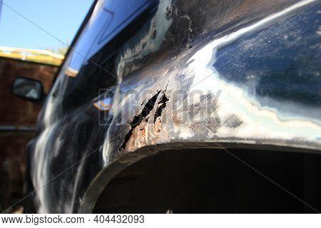 Metal Corrosion On A Car Fender, Rust Hole. Car Body Repair. Side View.
