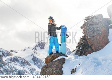 Young Woman Extreme Snowboarder On Freeride. Copy Space