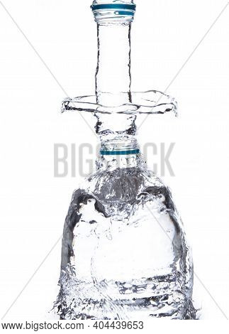 Overflowing Water In A Clear Bottle Fill The Bottle With Water Until The Water Spreads. White Backgr