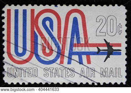 Istanbul, Turkey - December 25, 2020: Usa Stamp Shows Usa And Jet Circa 19698