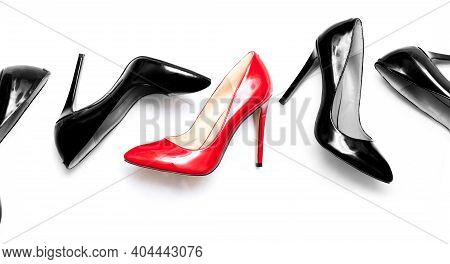 Beautiful Female Shiny Red And Black Stilettos On A White Background