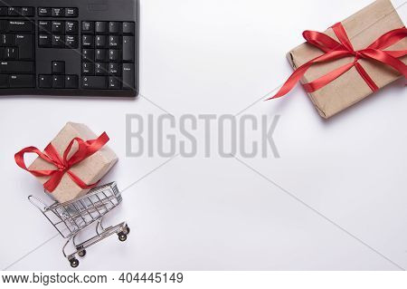 Flat Lay Collage Of Keyboard, Cardholder In Shopping Cart And Gift Boxes Isolated On White Backgroun