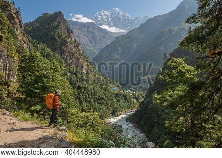 Trekker Looking To The Beautiful Landscape In Nepal With The View Of Mt.thamserku (6,623 M) A Fascin