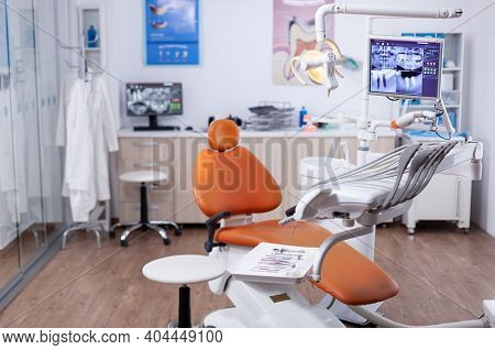 Dentists Office Interior With Modern Chair And Special Dentisd Equipment. The Interior Of Stomatolog