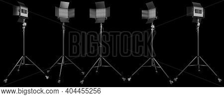 Photography Studio Led Flash Light On A Tripod Stand Isolated On Black.