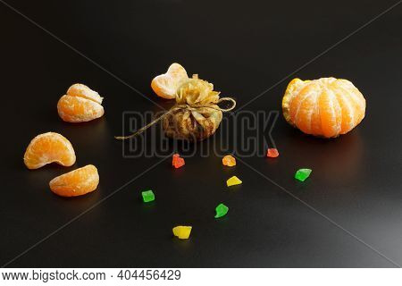 One Thin Ruddy Pancake With Filling, Wrapped In A Bag And Tied With Thread, Next To Candied Fruits A