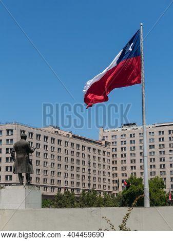 Santiago De Chile, Chile - January 26, 2018: Chileans Walking Near The Giant Flag On Avenida La Alam