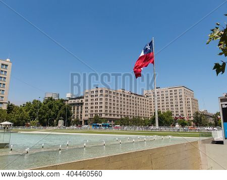Santiago, Chile - January 26, 2018: Chileans Walking Near The Giant Flag On Avenida La Alameda With