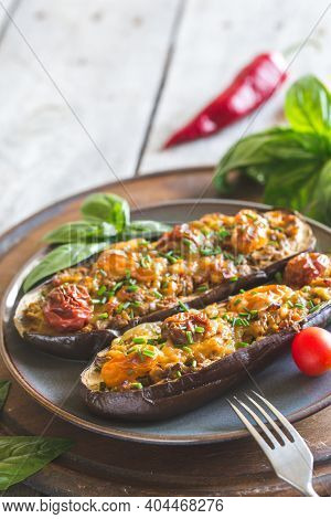 Baked Eggplant. Aubergine Stuffed With Vegetables And Cheese