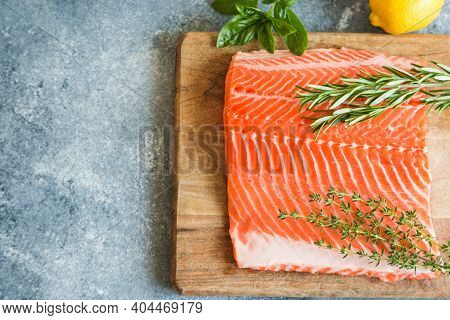 Salmon. Fresh Raw Salmon Fish Fillet With Cooking Ingredients, Herbs And Lemon. Close Up. Healthy Fo