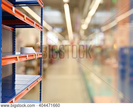 Almost Empty Shelves In Supermarket, Closeup. Product Deficiency Due To Social Panic