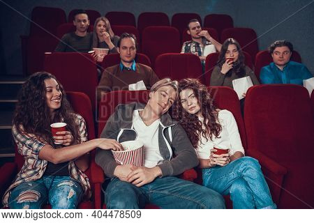People Came To See A Horror Movie In The Cinema. A Man With Frightened Eyes Came To The Cinema For A