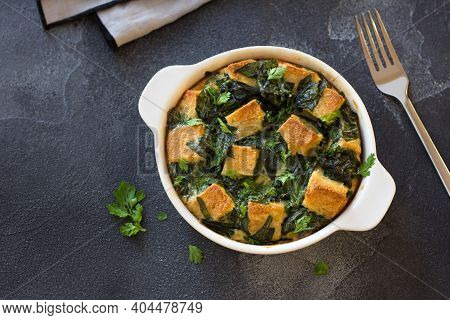 Baked Green Omelet With Spinach And Croutons, In White Form On Dark Textured Background, Flat Lay, S