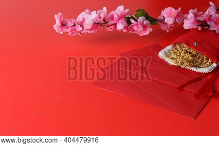 Chinese New Year Background - Red Envelope, Plum Flower And Gold Orament On Red Background