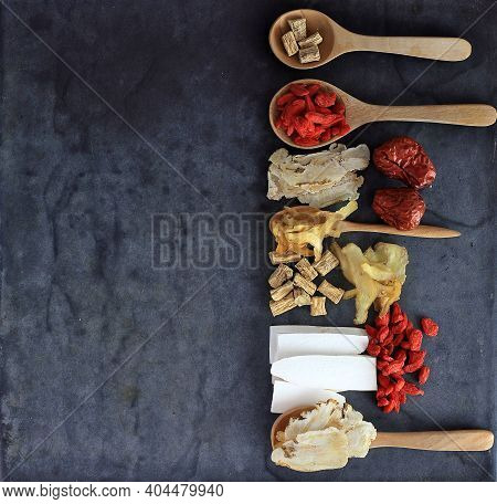 Top View Group Of Chinese Medicine Herbs On Black Background