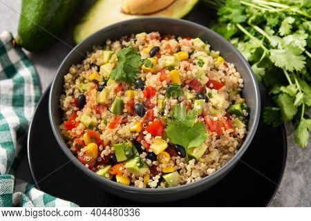 Mexican Salad With Quinoa In Bowl On Gray Stone Background