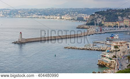 Nice, France - January 28, 2016: Lighthouse Jetti Pier At Port In Nice, France.