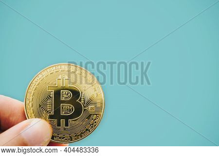 Hand Hold A Symbol Of Bitcoins As Digital Money Cryptocurrency With Nature Background With Copyspace