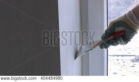Painting A Window Slope With A Brush With Water White Emulsion Paint, Decoration Background With Spa