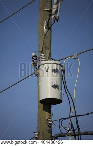 Electrical Transformer And Wires On An Electrical Pole