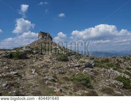View Of Limestone Tower Perda Liana, Impressive Rock Formation On Green Forest Hill, Sardinian Table