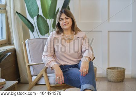 Portrait Portrait Of A Confident Mature Woman. Smiling Woman Looking At Camera With Big Grin. Succes
