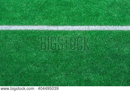 Green Synthetic Grass Sports Field With White Line Shot From Above. Soccer, Rugby, Football, Basebal
