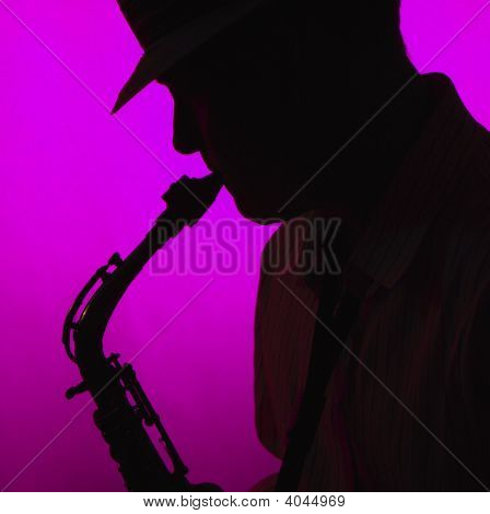 Saxophone Player Performer In Silhouette On Pink