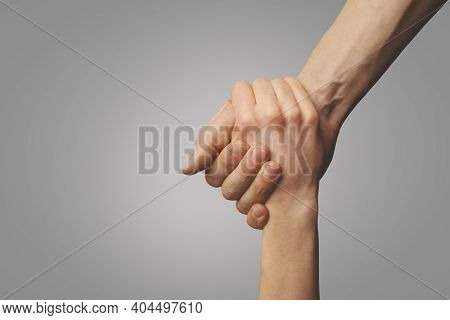 Help Friend Through A Tough Time. Rescue Gesture. Support, Friendship And Salvation Concept. Holding