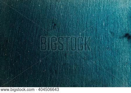 Black Slate Board On Dark Stone Texture Top View. Black Textured Slate Board On Dark Background