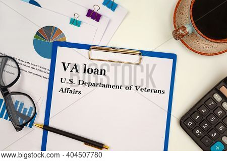 Paper With Va Loan - U.s. Departament Of Veterans Affairs On The Table, Calculator And Glasses