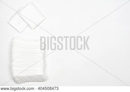 White Feminine Pads On White Background. Feminine Intimate Health And Hygiene Concepts With Copy Spa