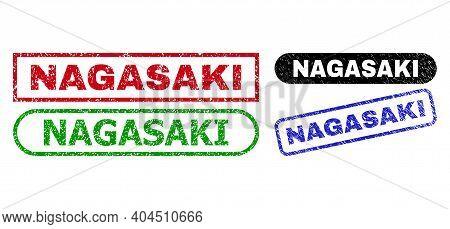 Nagasaki Grunge Seal Stamps. Flat Vector Grunge Stamps With Nagasaki Message Inside Different Rectan