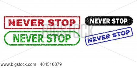 Never Stop Grunge Seal Stamps. Flat Vector Grunge Seal Stamps With Never Stop Title Inside Different